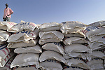 Stacks of grain await distribution to war's victims in a World Food Organization facility in Garsila, in Sudan's war-torn region of Darfur.