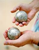 FRANCE, human hands holding pentaque balls, Saint-Paul de Vence