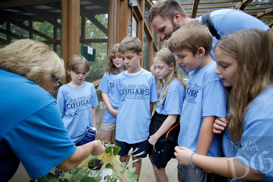 NWA Democrat-Gazette/DAVID GOTTSCHALK JoAnn McKim (left), a volunteer at the Botanical Garden of the Ozarks, speaks with third grade students from The New School Thursday, October 4, 2018, during Butterfly Days 2018 at the garden in Fayetteville. First through third grade students participated in the four day event that corresponded with science and biology curriculum at the school and featured  seven education stations about butterflies.