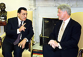 United States President Bill Clinton meets with President Hosni Mubarak of Egypt (L) during their meeting in the Oval office of the White House, July 1, 1999.   .Credit: Richard Ellis / Pool via CNP