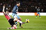 Nederland, Eindhoven, 30 januari  2013.KNVB Beker.Seizoen 2012/2013.PSV-Feyenoord.Mark van Bommel van PSV in duel om de bal met Anass Achahbar van Feyenoord