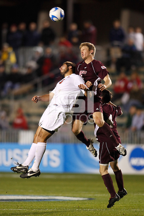 Ohio State Buckeyes forward Xavier Balc (3) and University of Massachusetts Minutemen defender Chris Brown (5) go up for a header during an NCAA College Cup semi-final match at SAS Stadium in Cary, NC on December 14, 2007. Ohio State defeated Massachusetts 1-0.
