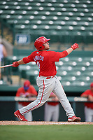 Philadelphia Phillies Juan Aparicio (4) follows through on a swing during a Florida Instructional League game against the Baltimore Orioles on October 4, 2018 at Ed Smith Stadium in Sarasota, Florida.  (Mike Janes/Four Seam Images)