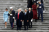 First Lady Melania Trump, United States President Donald Trump, Vice President Mike Pence, former president Barack Obama, former vice president Joe Biden,and Michelle Obama walk down the steps of the U.S. Capitol on January 20, 2017 in Washington, DC. In today's inauguration ceremony Donald J. Trump becomes the 45th president of the United States.<br /> Credit: Rob Carr / Pool via CNP