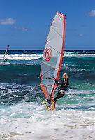 Windsurfers at Ho'okipa Beach on Maui. (NOTE: the man in the foreground is model released, the other is not model released.)