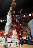 North Carolina State forward C.J. Leslie (5) shoots past Virginia forward/center Mike Tobey (10) during the game Saturday in Charlottesville, VA. Virginia defeated NC State 58-55.