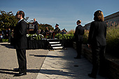 United States Secret Service personnel stand watch while U.S. President Donald J. Trump, center left, speaks during a ceremony to commemorate the September 11, 2001 terrorist attacks, at the Pentagon in Washington, D.C., U.S., on Monday, Sept. 11, 2017. Trump is presiding over his first 9/11 commemoration on the 16th anniversary of the terrorist attacks that killed nearly 3,000 people when hijackers flew commercial airplanes into New York's World Trade Center, the Pentagon and a field near Shanksville, Pennsylvania. <br /> Credit: Andrew Harrer / Pool via CNP
