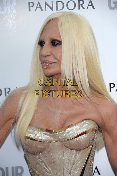 Donatella Versace.Women Of The Year 2012 - Glamour Awards, Berkeley Square, London, England..29th May 2012.headshot portrait gold corset strapless cleavage .CAP/PL.©Phil Loftus/Capital Pictures.