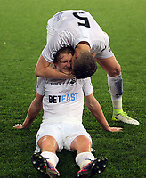Pictured: Keston Davies of Swansea City (TOP) kisses team mate George Byers of Swansea City after their win Monday 15 May 2017<br />
