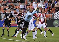 Chivas USA goalkeeper Zach Thornton (22) dives to make a save.  Chivas USA defeated DC United 2-0  at RFK Stadium, Saturday October 3, 2009.