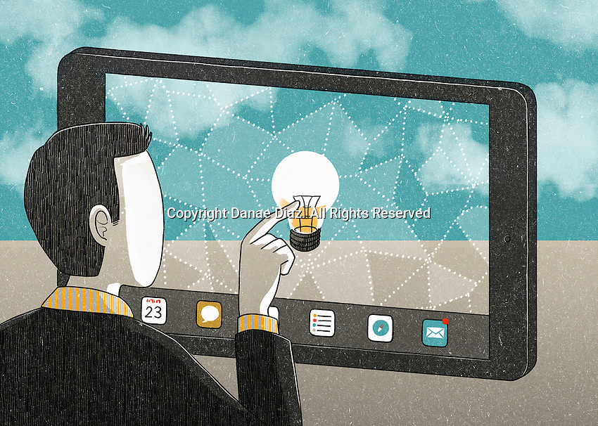 Businessman touching light bulb on tablet screen.ExclusiveImage