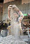 Meas Kimheng, 40, makes EM fertilizer at her home in Khnach, a village in the Kampot region of Cambodia.