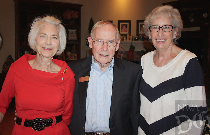 NWA Democrat-Gazette/CARIN SCHOPPMEYER Betsy Phillips (from left), Ed Clifford and Susan Barrett gather at a reception for the The Jones Trust on Dec. 8.