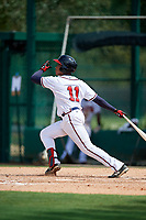 GCL Braves left fielder Charles Reyes (11) follows through on a swing during the second game of a doubleheader against the GCL Yankees West on July 30, 2018 at Champion Stadium in Kissimmee, Florida.  GCL Braves defeated GCL Yankees West 5-4.  (Mike Janes/Four Seam Images)