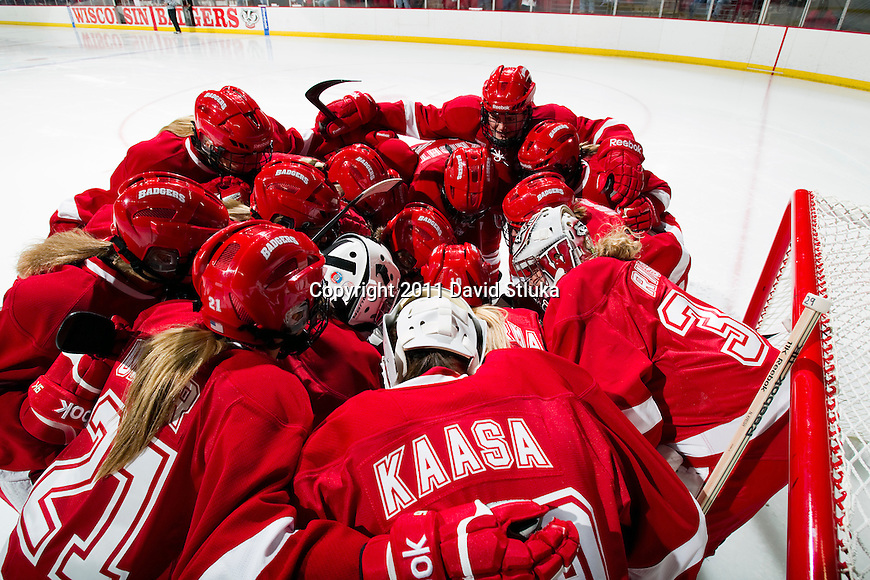 Wisconsin Badgers huddle prior to an NCAA Women's College Hockey game against Lindenwood University Lions on September 23, 2011 in Madison, Wisconsin. The Badgers won 11-0. (Photo by David Stluka)