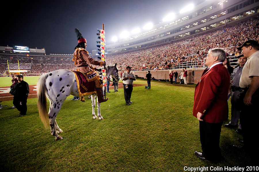TALLAHASSEE, FL 11/13/10-FSU-CLEMSON FB10 CH-Florida State President Eric Barron, right, admires Chief Osceola astride Renegade during the Clemson game Saturday at Doak Campbell Stadium in Tallahassee. The Seminoles beat the Tigers 16-13..COLIN HACKLEY PHOTO
