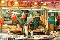 Near the bustling Times Square in Hong Kong, locals shop the street markets for meat, fish and produce..