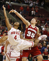 Ohio State's Tayler Hill (4) drives to score while Wisconsin's Jacki Gulczynski (35) defends in the second overtime during their NCAA basketball game Thursday, Feb. 7, 2013, in Columbus Ohio. (Photo for the Dispatch by Mike Munden)