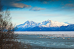 Snow coverd Chugach Mountains over Knik Arm. The ice flows on the water. Knik, Southcentral Alaska, Winter.