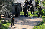 Israeli soldiers take position during clashes between Israeli settlers and Palestinian youths in the West Bank village of Yasuf south of Nablus, Friday, March 18, 2011. Photo by Wagdi Eshtayah