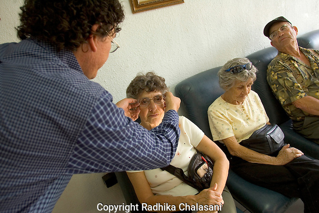 ALGODONES, MEXICO-MARCH 19: An optician fits a pair of glasses for an American senior citizen March 19, 2005 in Algdones. Eyeglasses are provided in an hour or two in most cases at prices as low as 50 USD. ©Radhika Chalasani