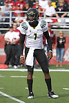 Oregon quarterback, Darron Thomas (#1), gets the play from the sidelines during the Ducks Pac-10 conference game against the Washington State Cougars at Martin Stadium in Pullman, Washington, on October 9, 2010.  In a game that went back and forth early in to the fourth quarter, Oregon finally prevailed over the Cougars, 43-23.