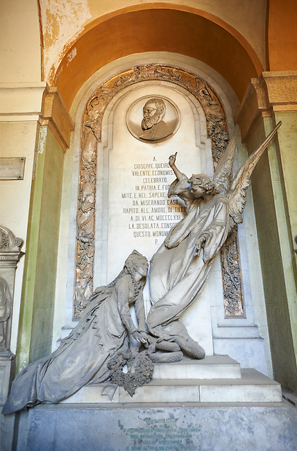Picture and image  of the stone sculptured monumental tombs depicting a flying angel and the deceased in the Borgeois Realistic style, by sculptor A Allegro 1872.  Section A, no 49, The Staglieno Monumental Cemetery, Genoa, Italy