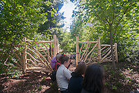 Visitors line up to enter the Hallett Nature Sanctuary in Central Park in New York on Monday, May 16, 2016. Closed since 1934 the  4 acre natural landscape in the middle of the city is a bird sanctuary and will be opened for limited times to the public only 20 people entering at a time. Hundreds lined up to be let in to admire the landscape. (© Richard B. Levine)