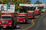 September 20, 2004 Angels Camp, California -- Tuolumne Fire –- Fire engines from all over the state travel through downtown Angels Camp to honor fallen firefighter Eva Marie Schicke whose memorial service was held at the Calaveras County Fairgrounds. The Tuolumne Fire was a small very fast-moving fire that started around noon on September 12, 2004 near Lumsden Bridge at the bottom of the Tuolumne River.  The fire moved rapidly up the 80-plus-degree slope catching Cal Fire Helitack firefighters, tragically killing firefighter Eva Marie Schicke and injuring five others.