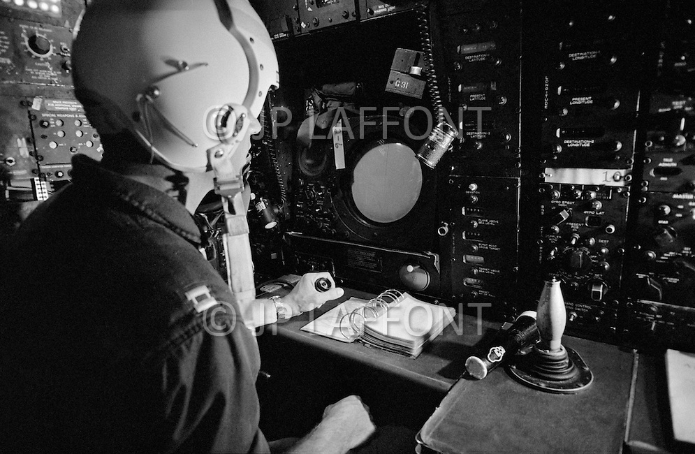 June 1972, Guam --- The Andersen Air Force Base on Guam Island from where the B-52 Stratofortress planes take off for Vietnam. A navigator observes the radar of a B-52 bomber. The nagivator also launches and directs the bombs. --- Image by © JP Laffont