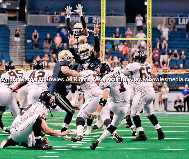 Aug 14, 2010: Orlando Predator placekicker Carlos Martinez (#1) attempts a last second field goal that would have won the game for the Predators over the Tampa Bay Storm.  The kick was too low, and the Storm defeated the Predators 63-62 to win the division title at the St. Petersburg Times Forum in Tampa, Florida. (Mandatory Credit:  Margaret Bowles)