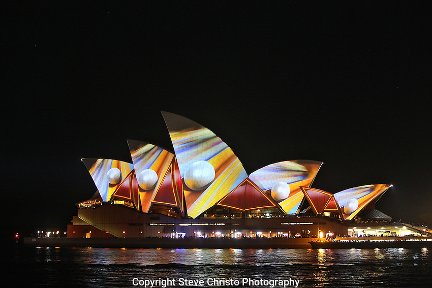 Vivid Sydney:  A Festival of Light, Music and ideas on the foreshore of Sydney Harbour.    Lighting the Sails is a colourful and eye popping visual spectacular which brings together the key elements of Vivid Sydney. Sydney, Australia. Wednesday May 29th 2013. Photo:( Steve Christo).