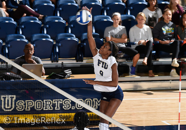Florida International University women's volleyball middle blocker Brianna Gogins (9) plays against  the University of Central Florida which won the match 3-0 on September 17, 2015 at Miami, Florida.