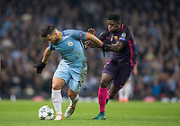 Sergio Aguero of Manchester City holds off Samuel Umtiti of Barcelona during the UEFA Champions League match between Manchester City and Barcelona at the Etihad Stadium, Manchester, England on 1 November 2016. Photo by Andy Rowland / PRiME Media Images.