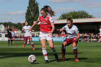 Lisa Evans of Arsenal and Laura Vetterlein of West Ham during Arsenal Women vs West Ham United Women, Barclays FA Women's Super League Football at Meadow Park on 8th September 2019