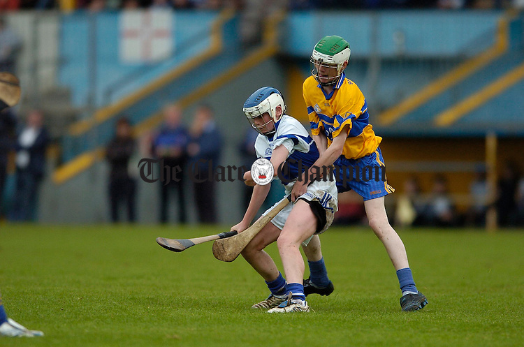 Kilmaley's John Cavey in action against Brian Devanney of Sixmilebridge during the U-15A hurling final at Cusack Park. Photograph by John Kelly.