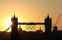23.07.2012. London England.  Sunset with the Olympic rings on the tower bridge in London, Great Britain. The London 2012 Olympic Games will start on 27 July 2012.