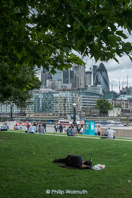 A man sleeping in Potters Fields, a public park next to the area around London City Hall managed by private company More London and owned by the Kuwaiti Sovereign Wealth Fund.