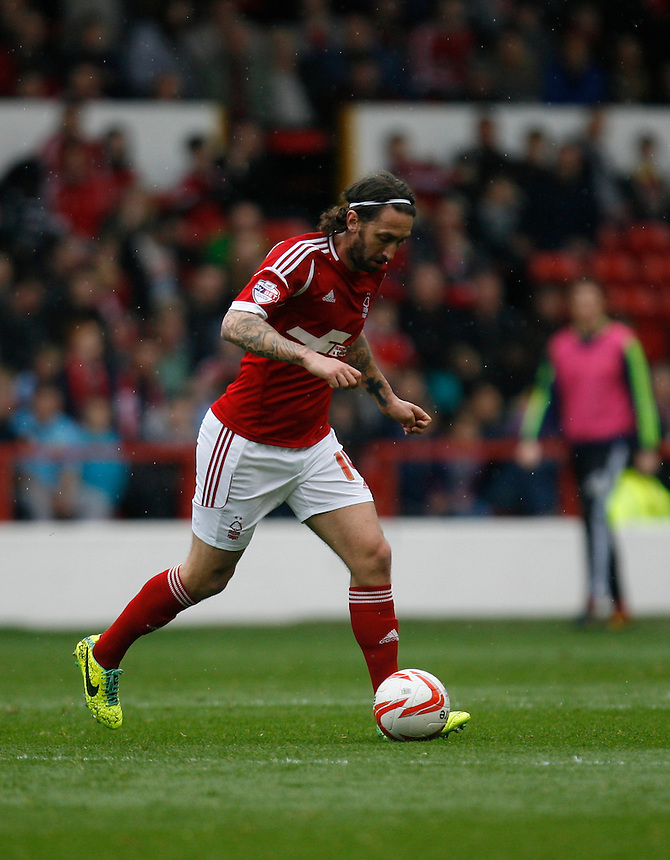 Nottingham Forest's Jonathan Greening in action during todays match  <br /> <br /> Photo by Jack Phillips/CameraSport<br /> <br /> Football - The Football League Sky Bet Championship - Nottingham Forest v Millwall - Saturday 5th April 2014 - The City Ground - Nottingham<br /> <br /> &copy; CameraSport - 43 Linden Ave. Countesthorpe. Leicester. England. LE8 5PG - Tel: +44 (0) 116 277 4147 - admin@camerasport.com - www.camerasport.com