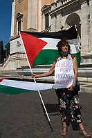 "Rome, 27/06/2020. Today, Pro-Palestinian activists and members of the public gathered in Piazza del Campidoglio, outside Rome City Hall, to protest (1.) against the Israeli annexation plan of 30% of the Palestinian Territories supported by the President of the United States, Donald Trump. The requests of the organisers are listed on their Facebook event page: «[…] - prevent the annexation of the Palestinian Territories to Israel; - sending of a UN interposition force which will also take care of the defense of Palestinian citizens and towns against attacks by Israeli soldiers and settlers; - recognition of the State of Palestine by the Italian government and the European Union; - convening of an international conference for peace in the Middle East, under the auspices of the United Nations, with the participation of all interested parties, on the basis of UN resolutions and in compliance with international laws, starting from the Geneva Convention. […] justice, peace and legality prevail and ensure freedom and self-determination for Palestinians is in everyone's interest, especially in countries bordering the Mediterranean, because, as Mandela said: ""We will never be free until the Palestinians are free"" […]». The demo was organized, amongst others, by the Palestinian Community in Rome and Lazio (2.), Assopace Palestina (3.) and Rete Romana di Solidarietà con il Popolo Palestinese (4.). Similar demonstrations were held contemporary in at least other 18 squares across Italy. During the event, the speech of the former Italian Prime Minister and Former Foreign Minister, Massimo D'Alema, sparked vibrant protests among some of the people attending the demo who left it while he was addressing the crowd.<br />
