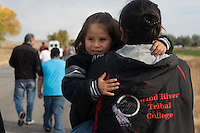 RyLee Good Left, 4, watches from mom Kayla Howling Buffalo's arms during a march from the local charter school to the site of a new language immersion school on the Wind River Indian Reservation in central Wyoming, Friday, Oct. 3, 2008. Northern Arapaho tribal leaders hope the inauguration of the larger new Arapaho Language Lodge immersion school at the reservation will help kids find a better cultural identity and strengthen them better succeed in education. (Kevin Moloney for the New York Times)