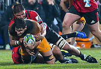 Crusaders' Whetu Douglas tackles Jaguares' Pablo Matera during the 2019 Super Rugby final between the Crusaders and Jaguares at Orangetheory Stadium in Christchurch, New Zealand on Saturday, 6 July 2019. Photo: Dave Lintott / lintottphoto.co.nz