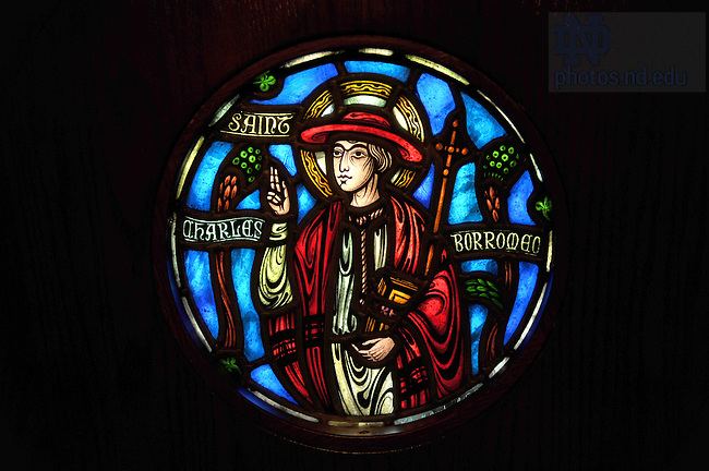 Stained Glass Window of St. Charles Borromeo in Alumni Hall Chapel..Photo by Matt Cashore/University of Notre Dame