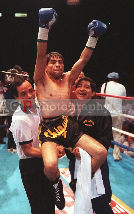 "Jul 24, 1990 - Inglewood, California, United States - Humberto ""Chiquita"" Gonzales is carried around the ring by his corner men July 24, 1990 in Inglewood,Calif., after defeating Jung-Keun Lim of Korea in their World Boxing Council light Flyweight Title Fight. Gonzales is from Mexico. .(Credit Image: © Alan Greth)"