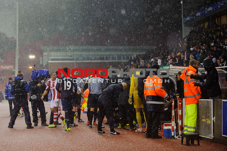 Players take shelter in the dugout during a hail storm that leads to a stop in play during the first half of the match -  - 18/12/2013 - SPORT - FOOTBALL - Britannia Stadium, Stoke - Stoke City v Manchester United - Capital One Football League Cup Quarter-Final.<br /> Foto nph / Meredith<br /> <br /> ***** OUT OF UK *****