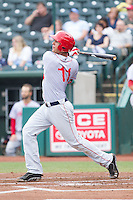 Drew Ward (11) of the Hagerstown Suns follows through on his swing against the Greensboro Grasshoppers at NewBridge Bank Park on May 20, 2014 in Greensboro, North Carolina.  The Grasshoppers defeated the Suns 5-4. (Brian Westerholt/Four Seam Images)