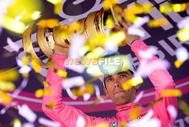 Alberto Contador (ESP) Tinkoff-Saxo celebrates with the trophy on the podium after winning the 98th Giro d'Italia 2015 at the end of the final Stage 21, running 178km from Turin to Milan. 31st May 2015. <br /> Photo: ANSA/Claudio Peri/www.newsfile.ie