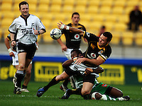 Wellington winger Apoua Stewart passes to the tackle of Tomasi Cama. Air NZ Cup - Wellington Lions v Manawatu Turbos at Westpac Stadium, Wellington, New Zealand. Saturday 3 October 2009. Photo: Dave Lintott / lintottphoto.co.nz