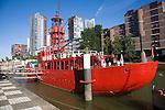 Historic red lightship floating restaurant and modern architecture Wijnhaven, Rotterdam, Netherlands