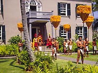 The King and his Royal Guards stand at the main entrance to the historic Hulihee Palace Museum in a mach ceremony. Palace located in the town of Kailua-kona along the west (kona) coast of the Big Island.